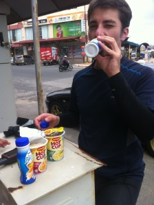 "Mike eating our ""Ramadan breakfast""- yogurt and cup of noodles from 7/11."